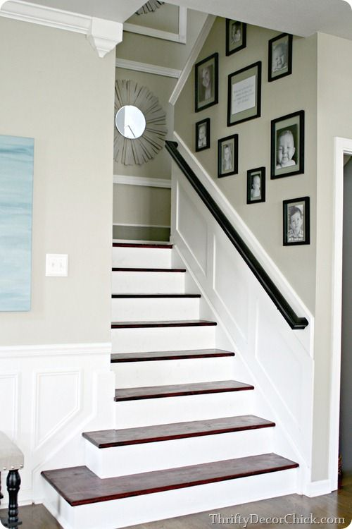 "white risers stained treads stairs... "" I love her gallery wall... I happen to like her style and taste in creativity.  I have the floating frames and the black & white idea as well... AND the mirror is also a like-minded piece... love this!! <3"
