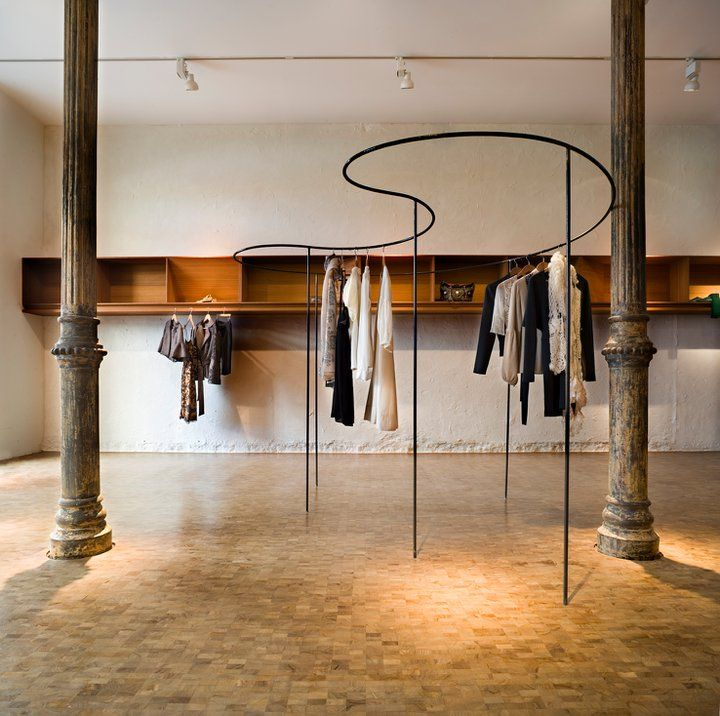 Working with the existing architecture to create organic clothes rails between the pillars