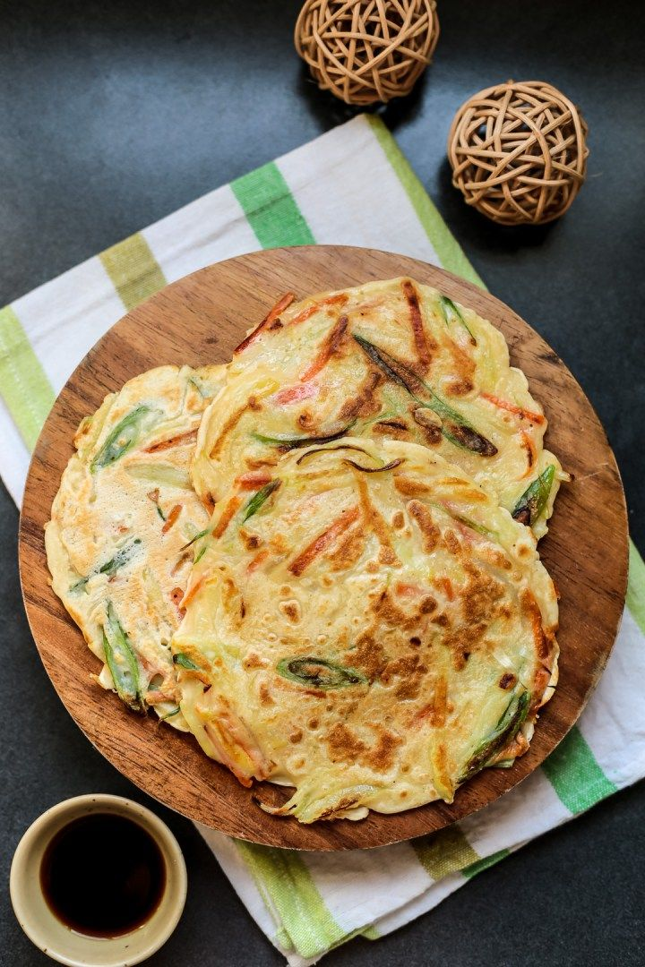 This seems more like yachaejeon (vegetable pancake). I prefer classic pajeon (green onion pancake) but I wouldn't say no to these either! Yum. One of my favorite Korean dishes and easy to make. Been craving them lately.