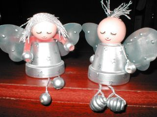 Plant pot, flower pot, cups (plastic or foam) or even yogurt pot fairies/angels.  Brilliant!