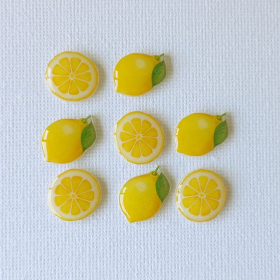 Lemon brooches.
