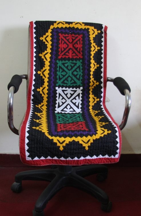 A #ralli quilted chair cover.