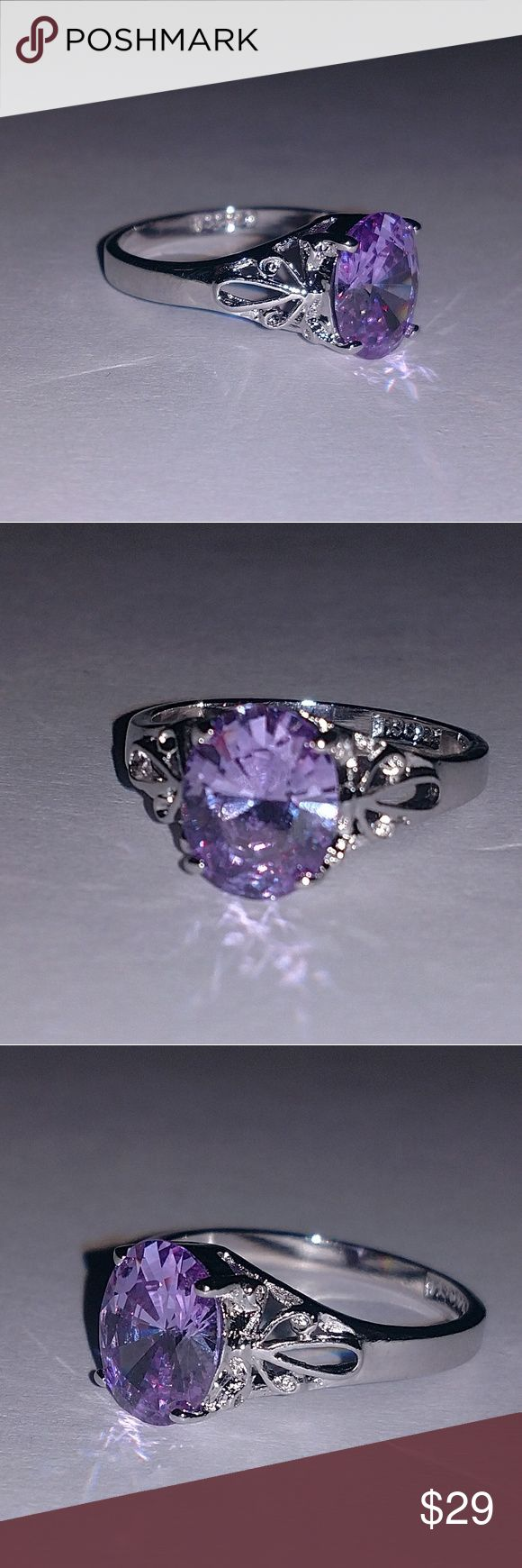 Sterling silver and purple ice ring This is a beautiful sterling silver ring with a stunning purple ice oval stone. It is a size 8.25. It is stamped 925 Jewelry Rings