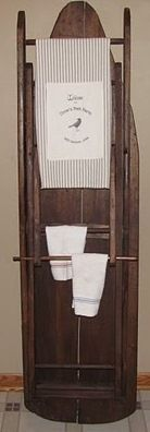 Ironing board as towel rack.  Got my great aunt's wooden ironing board but I still use it everyday.