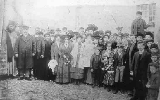 The christening of Evgenia Mavridoglou-Perdikaki at Saint Panteleimon, Moschonisi, 25 January 1910.