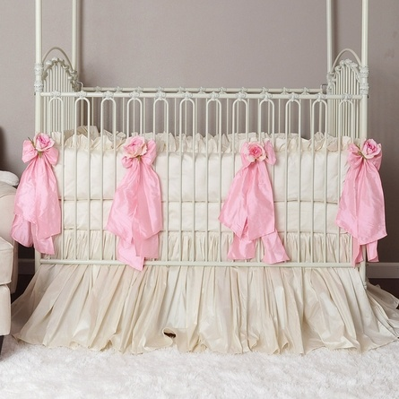 Beautiful baby girl bedding but in a softer pink. plus this is my crib but in gold
