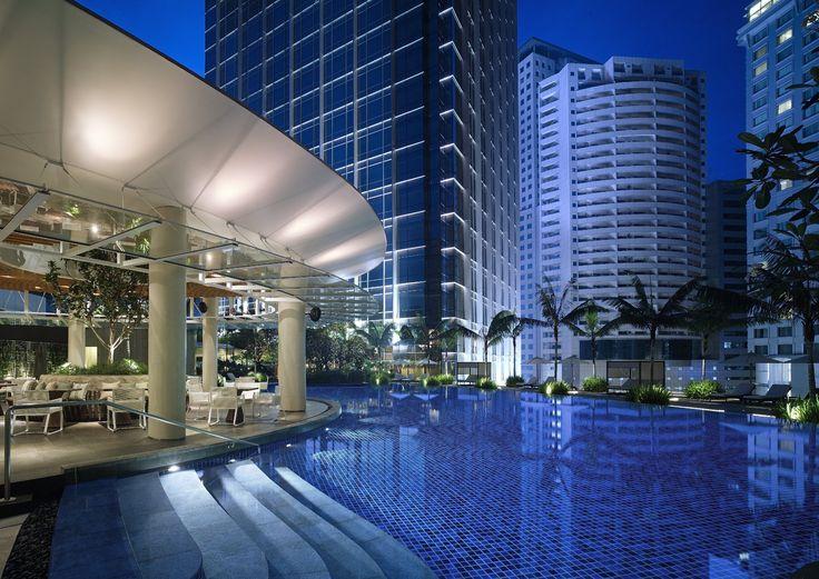 Enjoy an evening swim in the serene outdoor swimming pool at Grand Hyatt Kuala Lumpur.