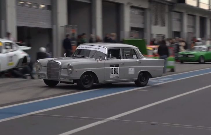 Chris Harris and David Coulthard race a Mercedes 220 Fintail at the Nürburgring