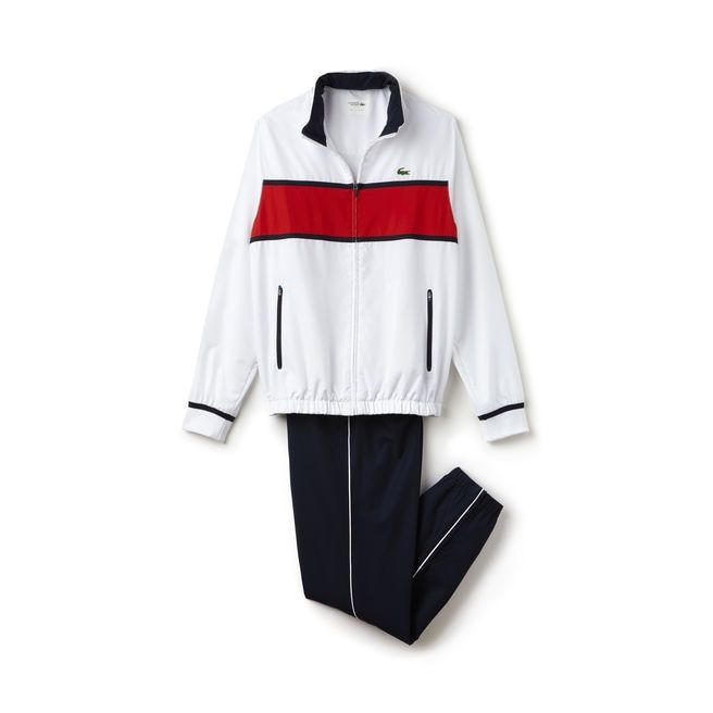 Lacoste SPORT Tennis keeps it moving with this taffeta tracksuit comprising a hooded jacket and elasticized pants. Fully lined for your comfort.