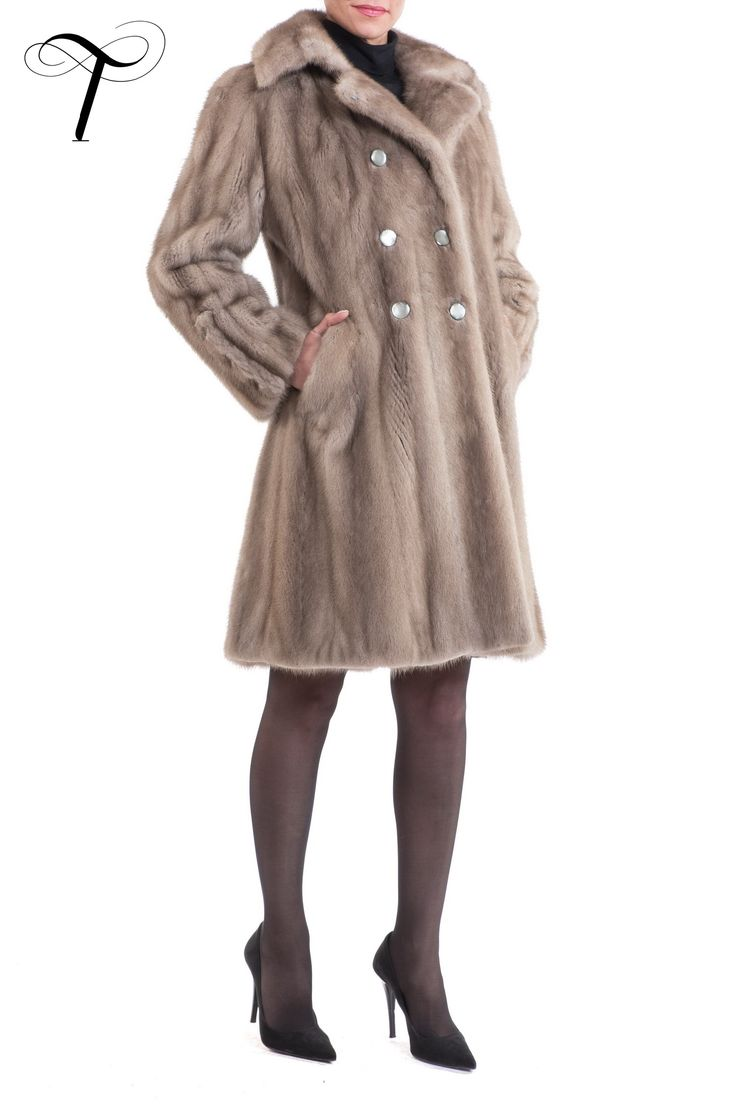 DOUBLE BREASTED MINK COAT   This  #doublebreasted #coat will add a #sophisticated finish to your appearance.Crafted from silver blue #mink #fur , it is cut closely to the figure and it has a notch collar . The coat is further embellished with three more matching triplets of buttons; two at each cuff and one at the rear pleat. It will be easy to pair with any #outfit . #toutountzisfurs #furcoat #fourrure #mexa #pelliccia #streetstyle #athens #minkfur #minkcoat #chic #elegant