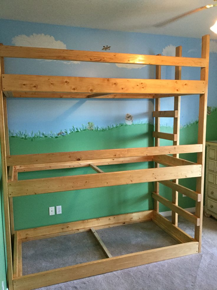 Triple bunk beds built by my husband.