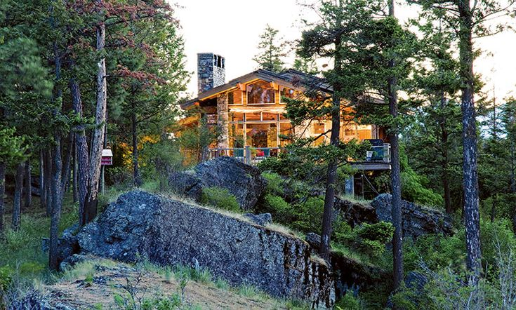 Perched atop a mountain in Bigfork, Montana, this peaceful retreat boasts a beautiful design, from the inside out.