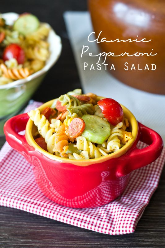 Classic Pepperoni Pasta Salad {  Tastes of Lizzy T } This Classic Pepperoni Pasta Salad is summer picnic comfort food at its best. Tri-color pasta, veggies, cheese and pepperoni fill this zesty Italian salad.