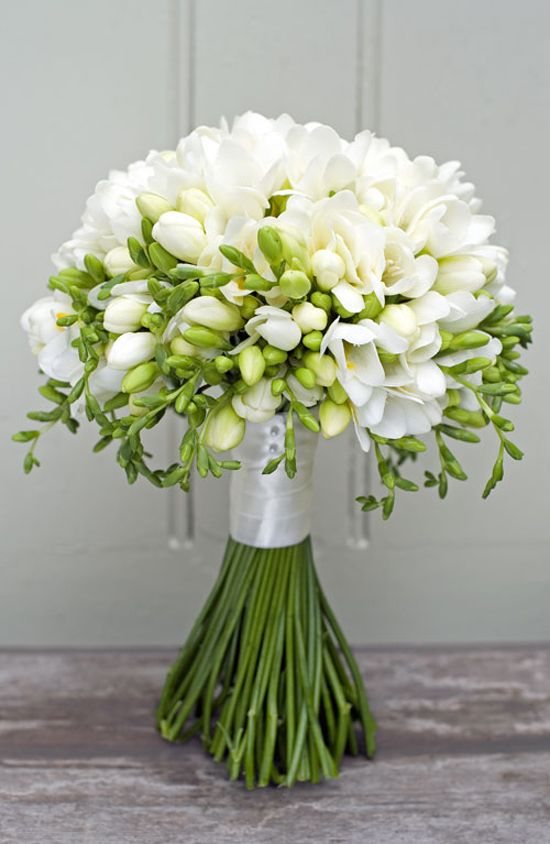 Bridal bouquet consisting of purely white freesias by Philippa Craddock Flowers