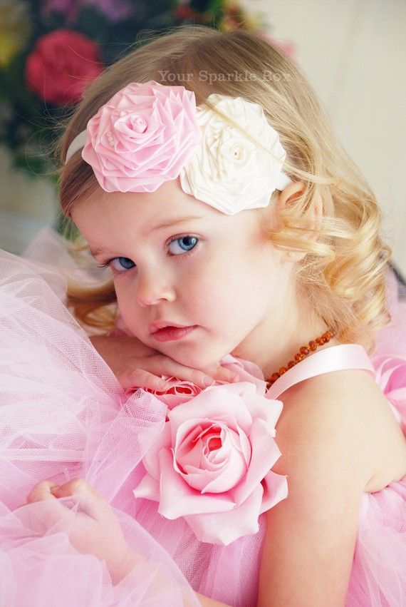 Pink flower girl dress with flower accents.