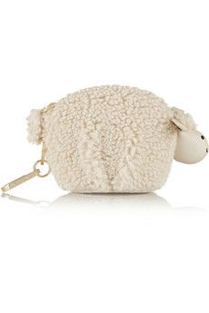 Larry Lamb knew he was about to be fed to the bears. Tory Burch Larry Lamb faux shearling keychain | NET-A-PORTER