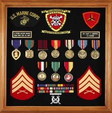 I like how they hung their medals. My marching band medals look similar... May hang them in a box like this, but with some pictures.