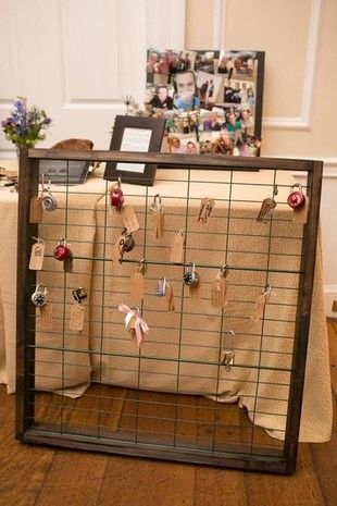 Inspired by the Pont des Arts bridge in Paris, where couples used to be able to attach locks as a symbol of their love, create a lock-and-key escort card display! {Amanda Hedgepeth Photography}