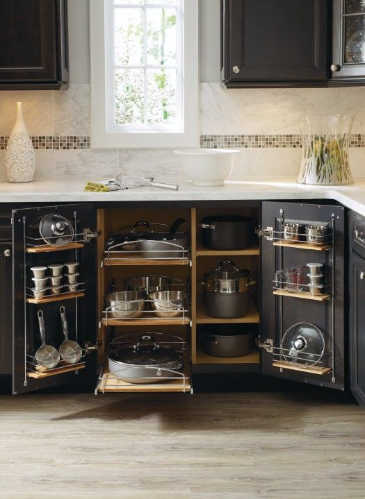 Pots, pans, and mixing bowls aren't a problem for Thomasville Cabinetry's Supercabinet. With pullout shelves and chrome door racks, it has enough space for all your storage needs.