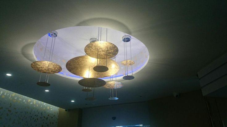custom lighting from zambelis lights.Gold leaf discs with led . . www.zambelislights.gr