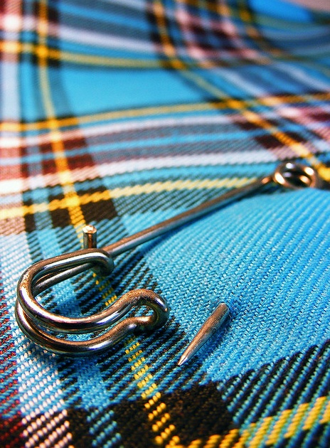 Bright kilt and pin.
