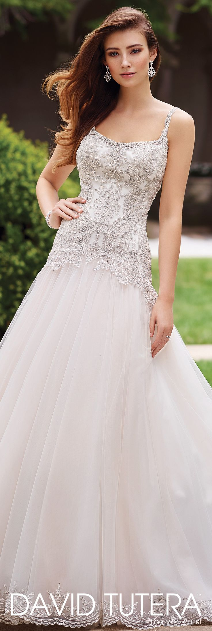 David Tutera for Mon Cheri - 117279 Carmelina - Sleeveless re-embroidered Alençon metallic lace on tulle over satin A-line gown with hand-beaded thin shoulder straps and softly curved neckline, beaded lace bodice with dropped waist, low scoop back finished with beaded illusion and pearl buttons, full tulle skirt with scalloped lace hemline and chapel length train.Sizes: 0 – 20, 18W – 26WColors: Ivory/Stone, Ivory, White