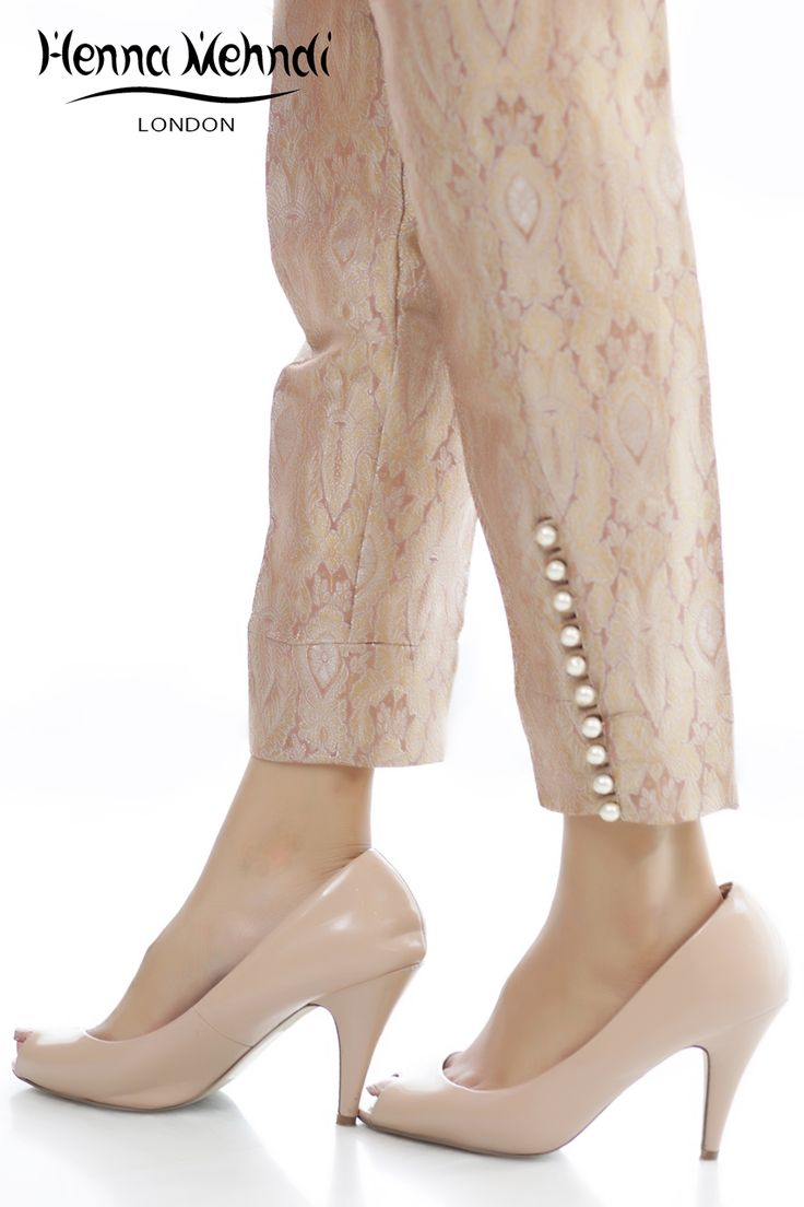 Pink jamavaar cigarette trousers with pearl buttons on sides.