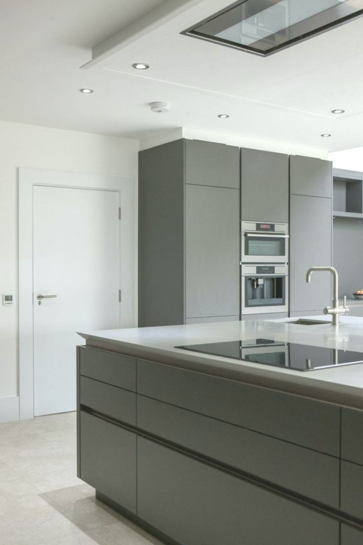 Warm Grey Corian Designed By Uber Kitchens Corian Designed Grey Kitchens Kitchen Inspiration Design Modern Grey Kitchen Contemporary Kitchen Cabinets