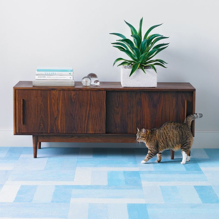 DIY flooring patterns with cork, rug, or lino tiles you cut and piece yourself. ..These days, a great-looking floor is within everyone's reach, thanks to three types of easy-to-install tiles: cork, linoleum, and carpet. With just a few basic tools and minimal cutting, you can use these tiles to create a variety of flooring motifs, from bold stripes to abstract houndstooth.