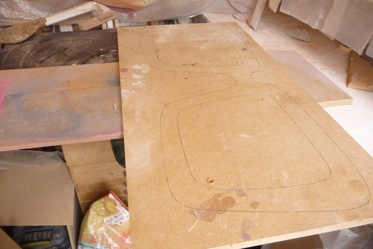 Holes have been drill in and around the board, so I can easy get in my jigsaw blade and cut the shapes out...