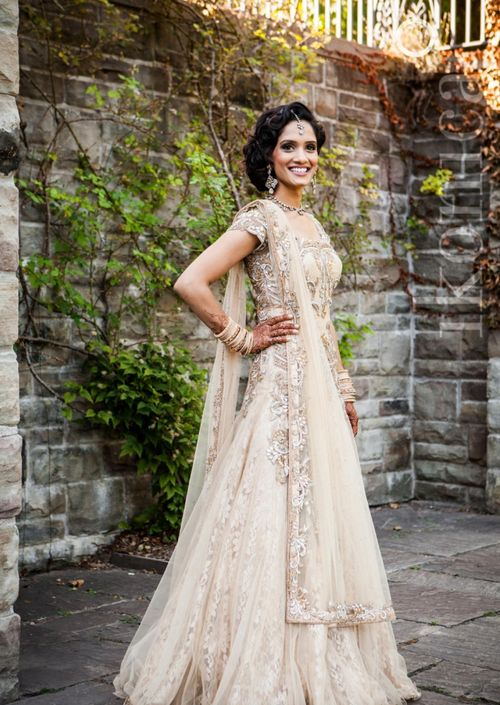 Reception lehenga.  Photo by:Ikonica Bride's dress custom designed by CTC West Canada