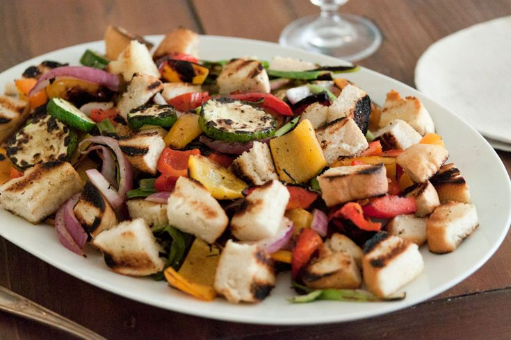 A Grilled Summer Panzanella Salad with buttery toasted bread, grilled peppers and onions and zucchini.