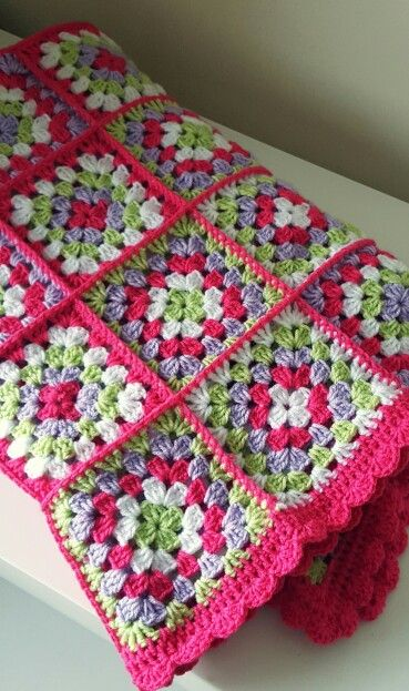 Granny square blanket with scalloped edge made for mothers day.