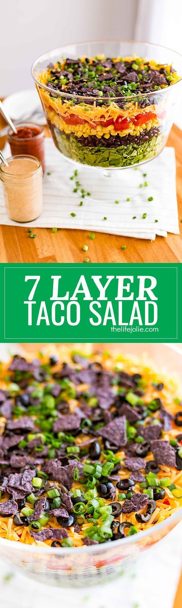 This 7 Layer Taco Salad is an easy recipe to make for parties. Full of delicious Mexican-inspired flavors it's got seven (or more) layers of things like beans, cheese, corn, tomatoes and is served with a creamy taco ranch dressing. Top it with chicken for