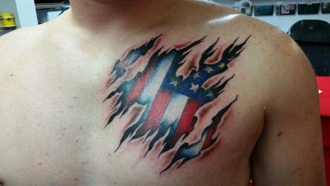 Skin tear American flag tattoo
