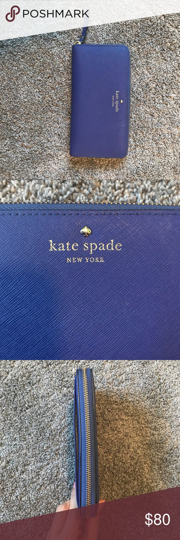Cameron Street Lacey Kate Spade Cameron Street Lacey wallet in a cobalt blue color! There is an outside pocket, and this wallet does zip close. There are 12 credit card slots, six on each side and a pocket behind each. There is a pocket in the middle for money and then a zip enclosure for coins. Where the money goes, there are three little spots on the bottom left, and the first pocket when opening up has a barely noticeable lipstick stain, I pictured both! Otherwise this wallet looks brand…