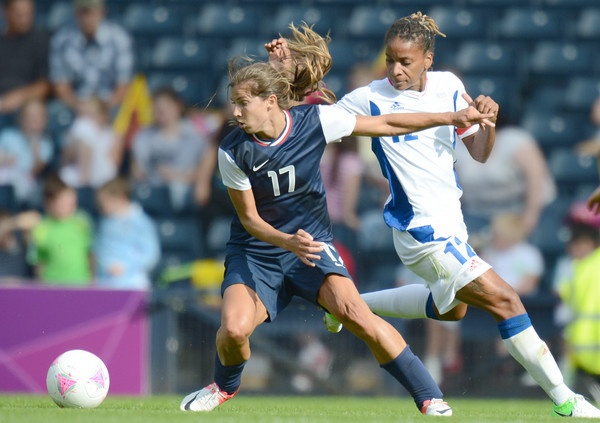 USA midfielder Tobin Heath (17) defends against France forward Elodie Thomis (12) during the womens preliminary match before the London 2012 Olympic Games at Hampden Park.