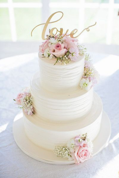 White, pink and gold wedding cake idea - three-tier white wedding cake with pink roses + gold LOVE modern calligraphy cake topper {Willow Noavi Photography}
