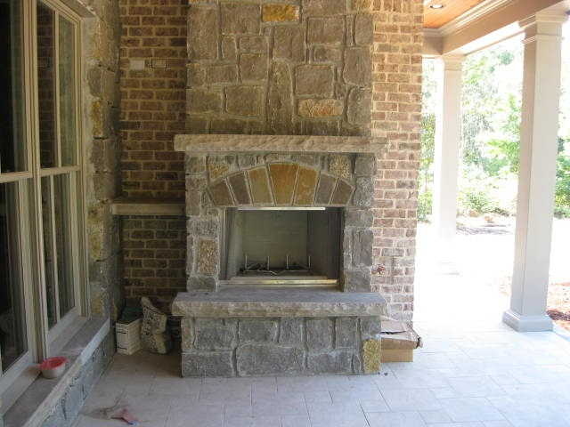 Outdoor prefab wood burning fireplace under construction for New construction wood burning fireplace
