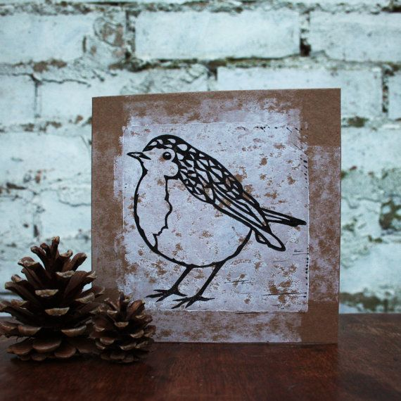 Hand made linocut christmas cards, Robin.