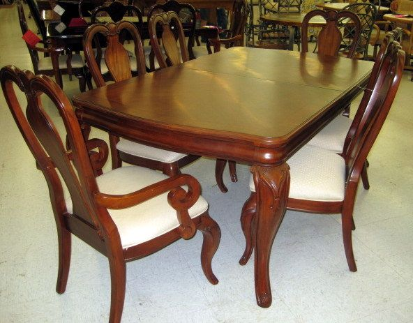 72 X 44 X 31 Cherry Finish Dining Table. Has Rounded Ends. Carved Queen Anne  Legs. Has 4 Side And 2 Capt. Chairs. Chairs Have Splat Back W/ Scrolled Top.