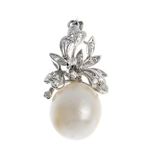 A cultured pearl and diamond pendant.