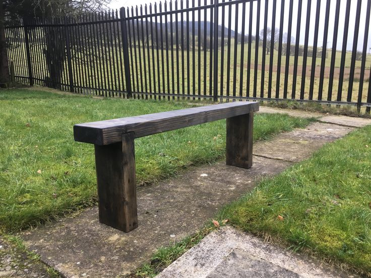 A simple bench made from a reclaimed roofing joist, finished with black wood dye and black furniture wax.