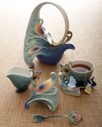 """Luminescence Peacock"" Tea Set at Horchow (very impractical but interesting elements to try . . . the looped handle is a cool idea)"