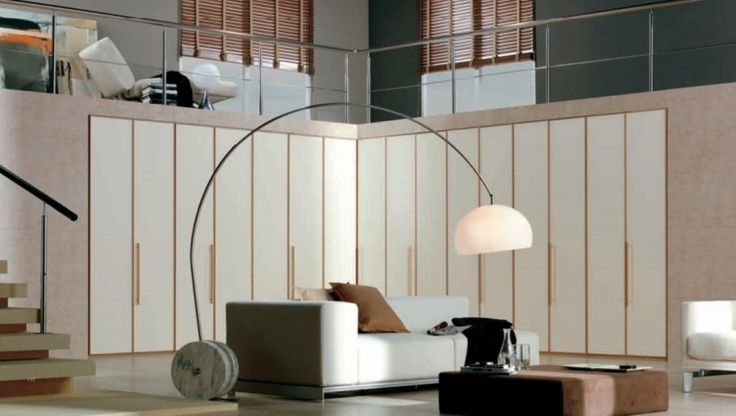 Cool Big Corner Wardrobe With White Multi Purpose Wardrobe Cabinet As Well As White Comfy Sofa Also Unique Curved Standing Lamp Design Ideas: Beautify Your Room with Modern Minimalist Wardrobe Designs