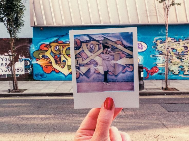 A photo within a photo is a quick and easy visual trick that can be used to create quirky pictures. You can snap a person, place or thing, though the more distinctive the location the better the picture will be.