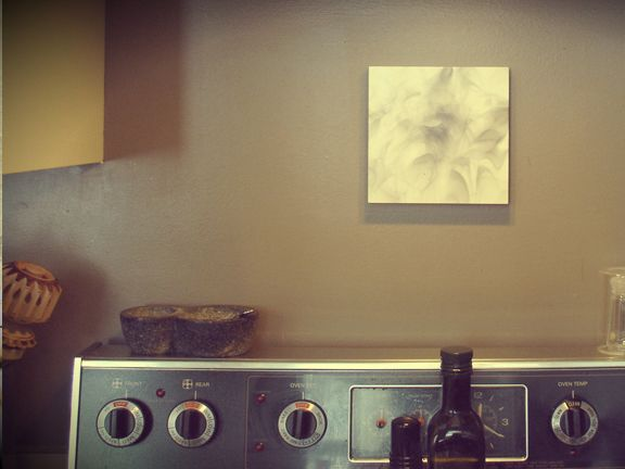 Fumage painting by Quintin Gonzalez above the stove. Granite salt and pepper bowl.
