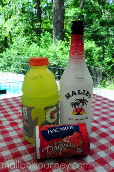 Liquid Skittles: 6 oz. Malibu Mango Rum, 12 oz. Strawberry Daiquiri Frozen Mix, 6 oz. Gatorade Lemon-Lime