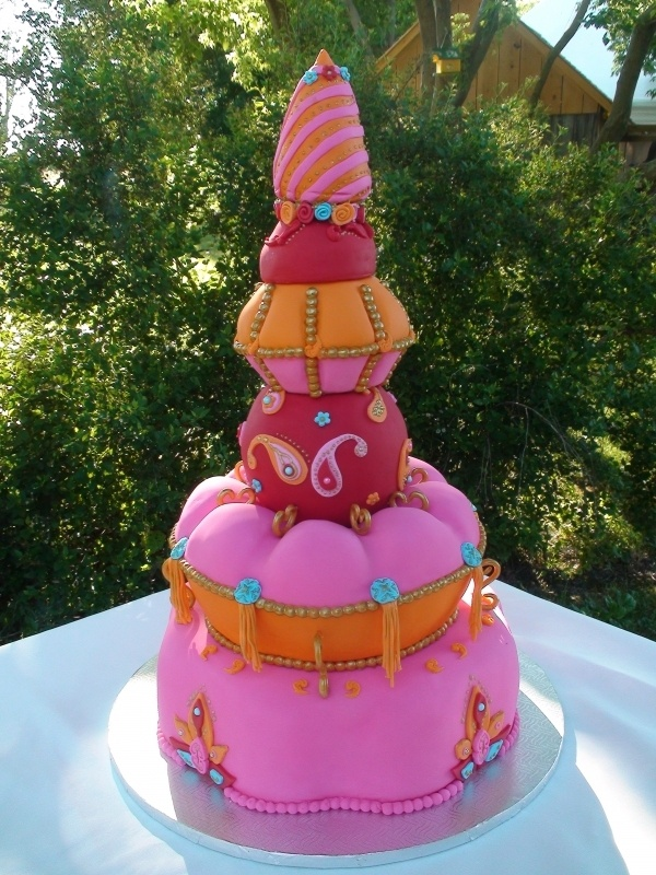 bollywood pink, orange, red and turquoise cake