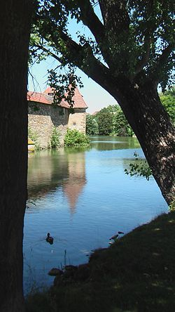 Quaint Seeweiher, a water filler moat surrounding the medieval walls of Franconian town Weißenburg in Bayern (courtesy of Wikipedia).  The walls and towers have been converted into quaint holiday apartments with open beams and decorative plaster work.